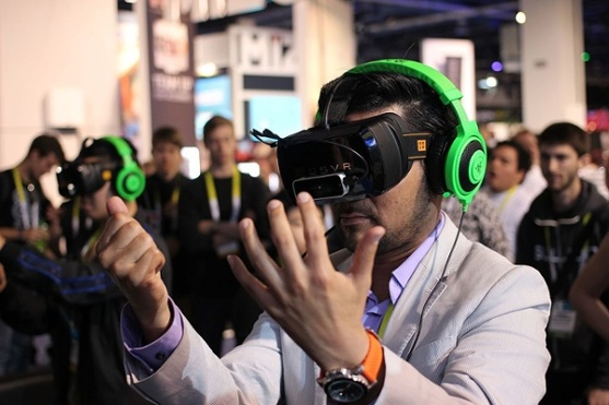 Young-man-using-the-Razer-OSVR-Open-Source-Virtual-Reality-device-for-Gaming
