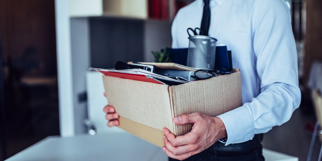 businessman-carrying-a box-of-office-supplies-after-a-digital-transformation