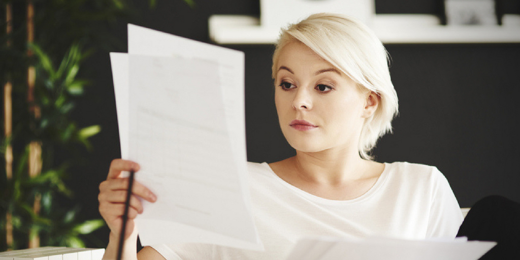 young-business-woman-analyzing-telecom-business-expenses